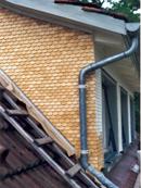 Reparatur einer Schindel Fassade